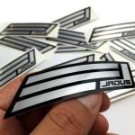 Jadus aluminium klistermärke